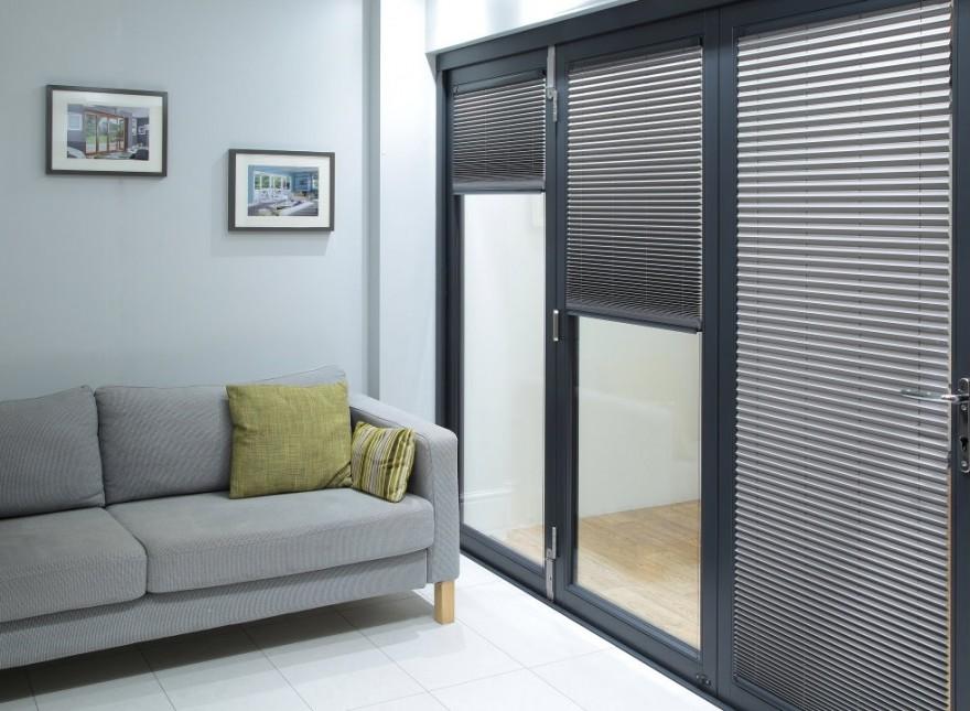 Select Grey 3.6M Bifold doors Grey trim Blinds partially open